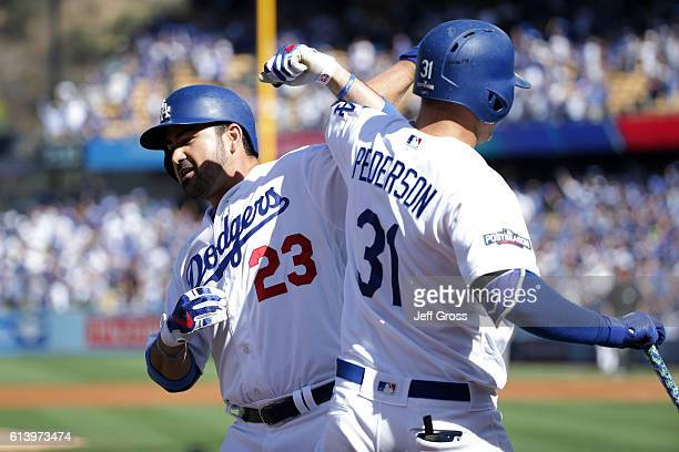 Adrian Gonzalez celebrates his tworun homerun with Joc Pederson of the Los Angeles Dodgers in the first inning against the Washington Nationals...