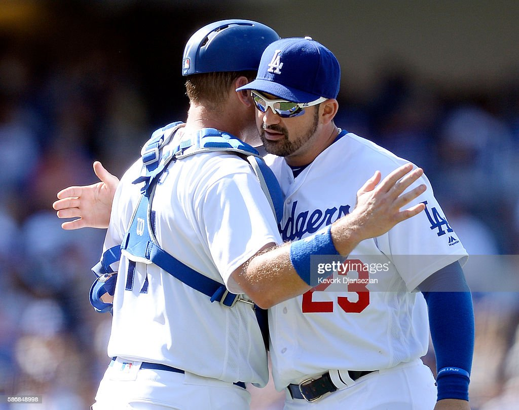 Adrian Gonzalez of and catcher AJ Ellis of the Los Angeles Dodgers celebrate after they shut out the Boston Red Sox 30 at Dodger Stadium Stadium...