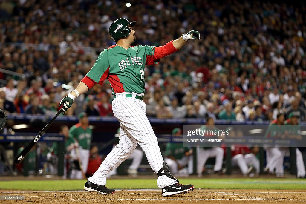 Adrian Gonzalez #23 of Mexico hits a 2-run home run in the top of the third inning against the United States during the World Baseball Classic First Round Group D game at Chase Field on March 8, 2013 in Phoenix, Arizona.