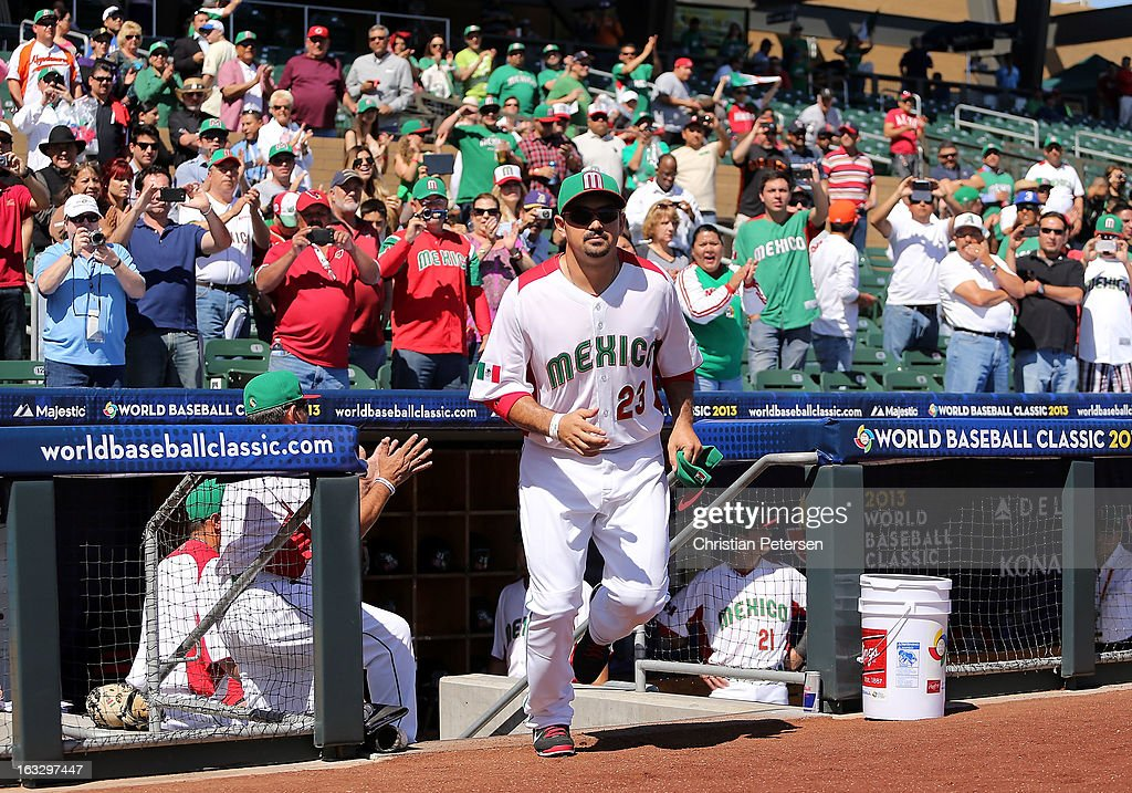 Adrian Gonzalez #23 of Mexico runs out onto the field during introductions to the World Baseball Classic First Round Group D game against Itlay at Salt River Fields at Talking Stick on March 7, 2013 in Scottsdale, Arizona.