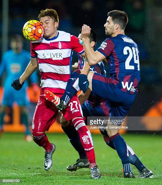 Adrian Gonzalez of SD Eibar duels for the ball with Adalberto Penaranda of Granada CF during the La Liga match between SD Eibar and Granada CF at...