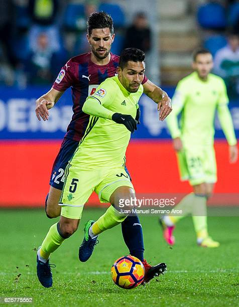 Adrian Gonzalez of SD Eibar duels for the ball with Petros Matheus dos Santos of Real Betis during the La Liga match between SD Eibar and Real Betis...