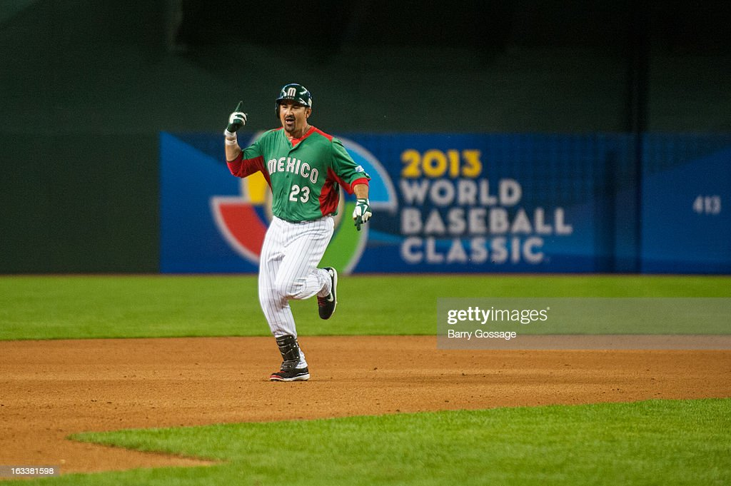 Adrian Gonzalez #23 of Team Mexico celebrates as he rounds the bases after hitting a two-run home run in the top of the third inning of Pool D, Game 3 against Team USA at Chase Field on Friday, March 8, 2013 in Phoenix, Arizona.