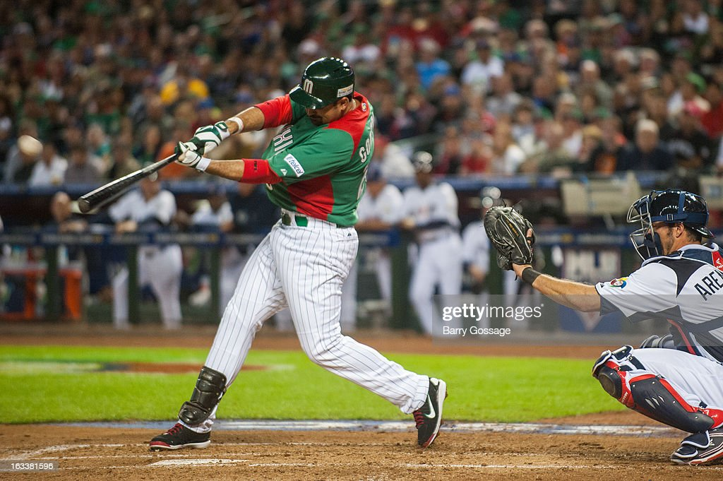 Adrian Gonzalez #23 of Team Mexico hits a two-run home run in the top of the third inning of Pool D, Game 3 against Team USA at Chase Field on Friday, March 8, 2013 in Phoenix, Arizona.