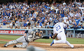 Adrian Gonzalez of the Los Angeles Dodgers avoids the tag of catcher Derek Norris of the San Diego Padres to score a run in the first inning at...