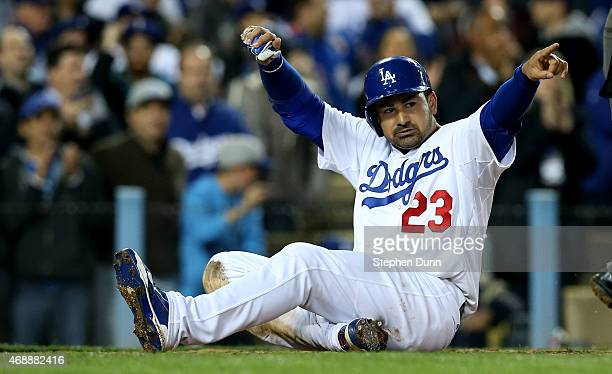 Adrian Gonzalez of the Los Angeles Dodgers celebrates after sliding home with a run in the sixth inning against the San Diego Padres at Dodger...