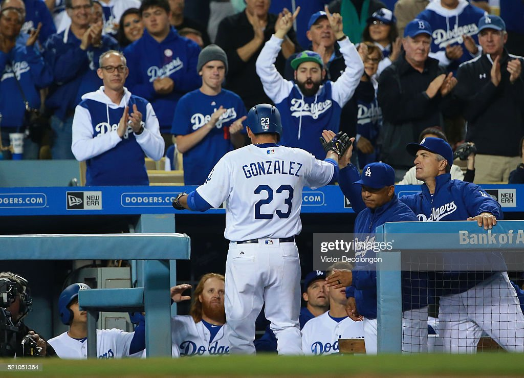 Adrian Gonzalez of the Los Angeles Dodgers celebrates his solo homerun with teammates in the dugout in the fourth inning against pitcher Rubby De La...