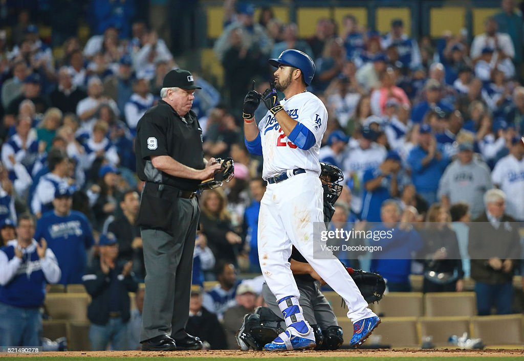 Adrian Gonzalez of the Los Angeles Dodgers crosses home plate after hitting a solo homerun in the fourth inning against pitcher Rubby De La Rosa of...