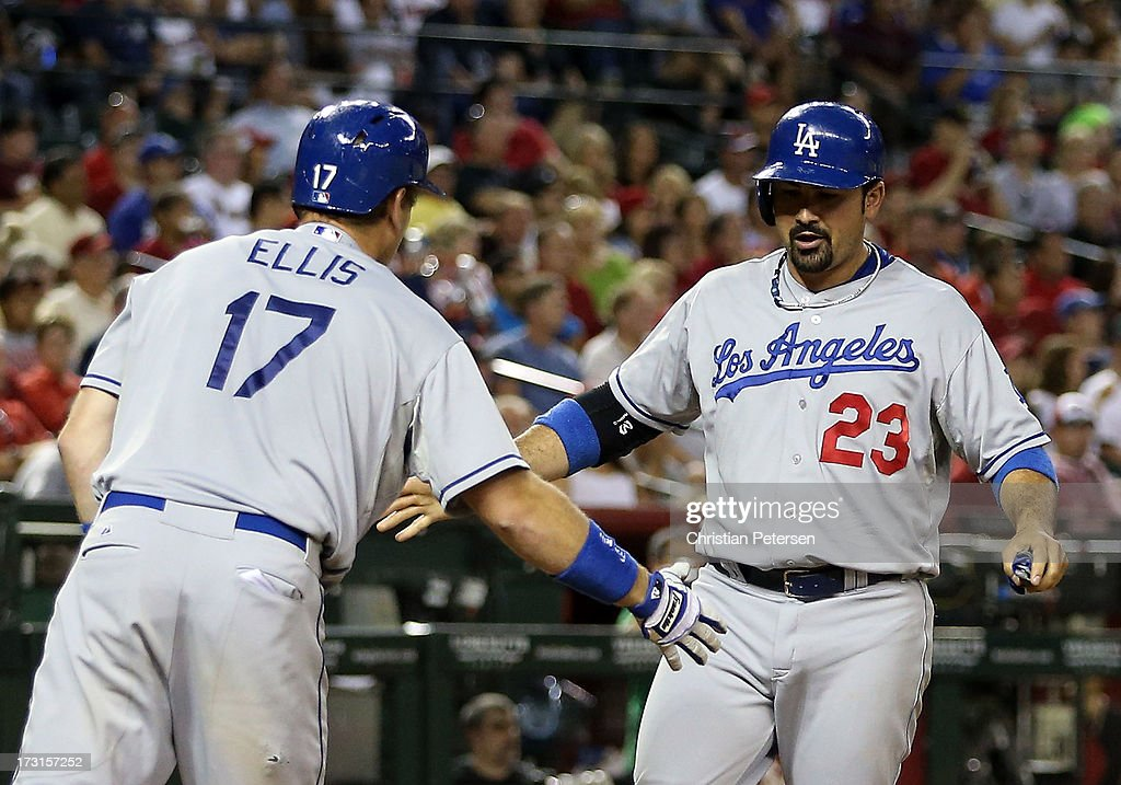 <a gi-track='captionPersonalityLinkClicked' href=/galleries/search?phrase=Adrian+Gonzalez+-+Baseball+Player&family=editorial&specificpeople=4488118 ng-click='$event.stopPropagation()'>Adrian Gonzalez</a> #23 of the Los Angeles Dodgers high-fives A.J. Ellis #17 after scoring against the Arizona Diamondbacks during the seventh inning of the MLB game at Chase Field on July 8, 2013 in Phoenix, Arizona.