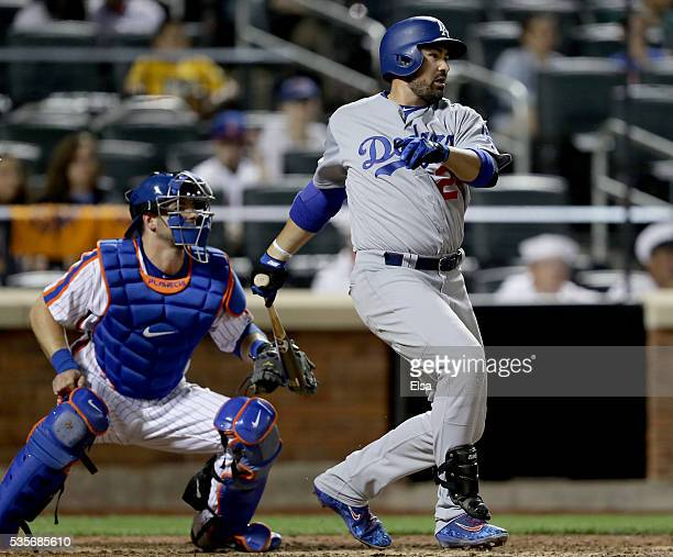 Adrian Gonzalez of the Los Angeles Dodgers hits a 2RBI single in the ninth inning as Kevin Plawecki of the New York Mets defends at Citi Field on May...