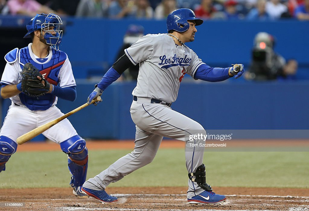 Adrian Gonzalez #23 of the Los Angeles Dodgers hits a single in the fifth inning during MLB game action against the Toronto Blue Jays on July 24, 2013 at Rogers Centre in Toronto, Ontario, Canada.