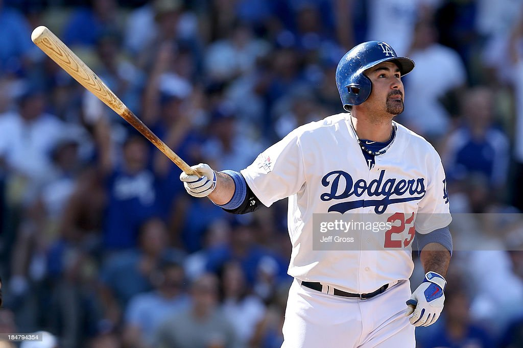Adrian Gonzalez #23 of the Los Angeles Dodgers hits a solo home run in the third inning against the St. Louis Cardinals in Game Five of the National League Championship Series at Dodger Stadium on October 16, 2013 in Los Angeles, California.