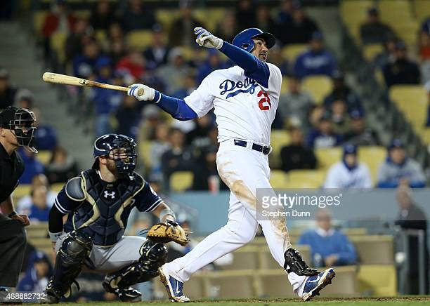 Adrian Gonzalez of the Los Angeles Dodgers hits a solo home run in the eighth inning against the San Diego Padres at Dodger Stadium on April 7 2015...
