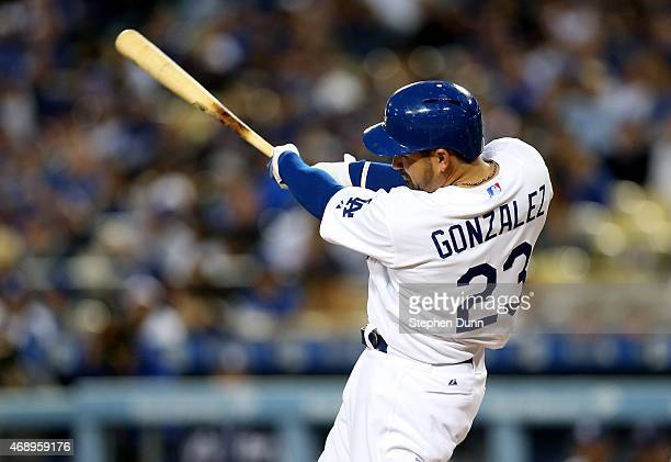 Adrian Gonzalez of the Los Angeles Dodgers hits a solo home run in the first inning against the San Diego Padres at Dodger Stadium on April 8 2015 in...