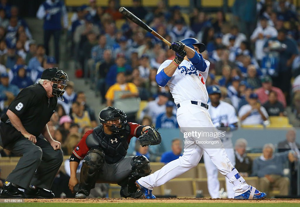 Adrian Gonzalez of the Los Angeles Dodgers hits a solo homerun in the fourth inning against pitcher Rubby De La Rosa of the Arizona Diamondbacks...