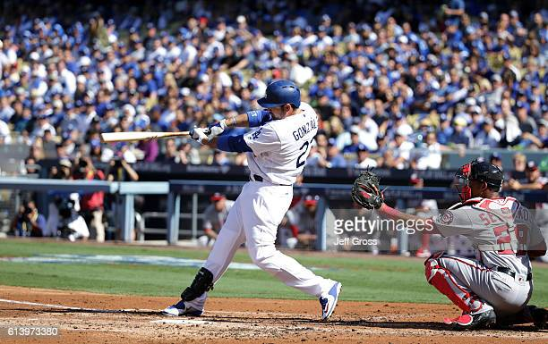 Adrian Gonzalez of the Los Angeles Dodgers hits a tworun homerun in the first inning against the Washington Nationals during game four of the...