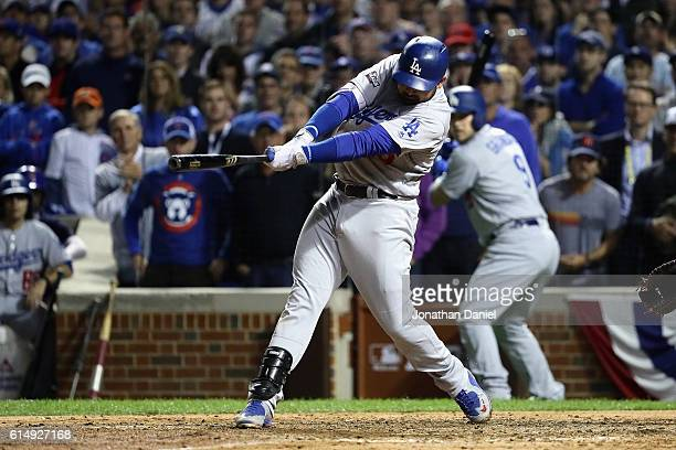 Adrian Gonzalez of the Los Angeles Dodgers hits a tworun RBI single in the eighth inning against the Chicago Cubs during game one of the National...