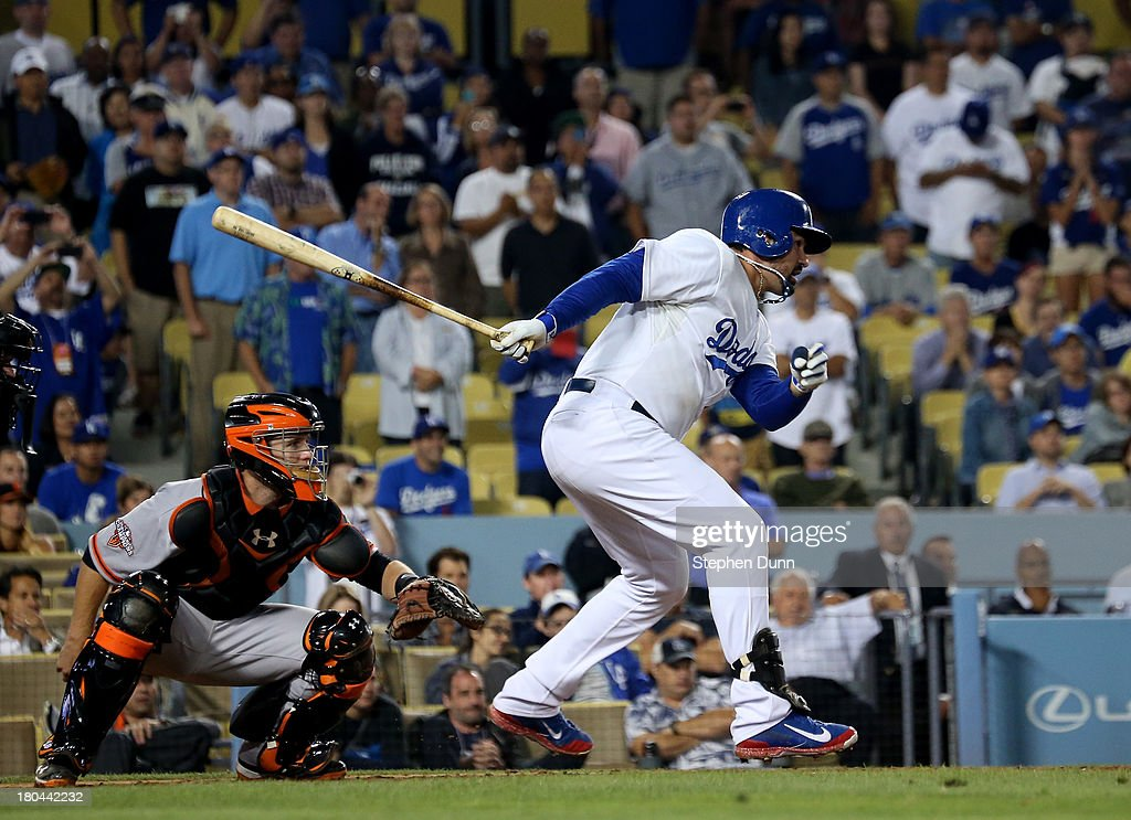 Adrian Gonzalez #23 of the Los Angeles Dodgers hits a walk off RBI single in the tenth inning to win the game against the San Francisco Giants at Dodger Stadium on September 12, 2013 in Los Angeles, California. The Dodgers won 3-2 in ten innings.