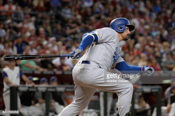 Adrian Gonzalez of the Los Angeles Dodgers hits an RBI double in the second inning against the Arizona Diamondbacks at Chase Field on August 31 2017...