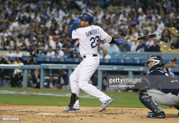 Adrian Gonzalez of the Los Angeles Dodgers hits an rbi double to deep left in the first inning during the MLB game against the San Diego Padres at...