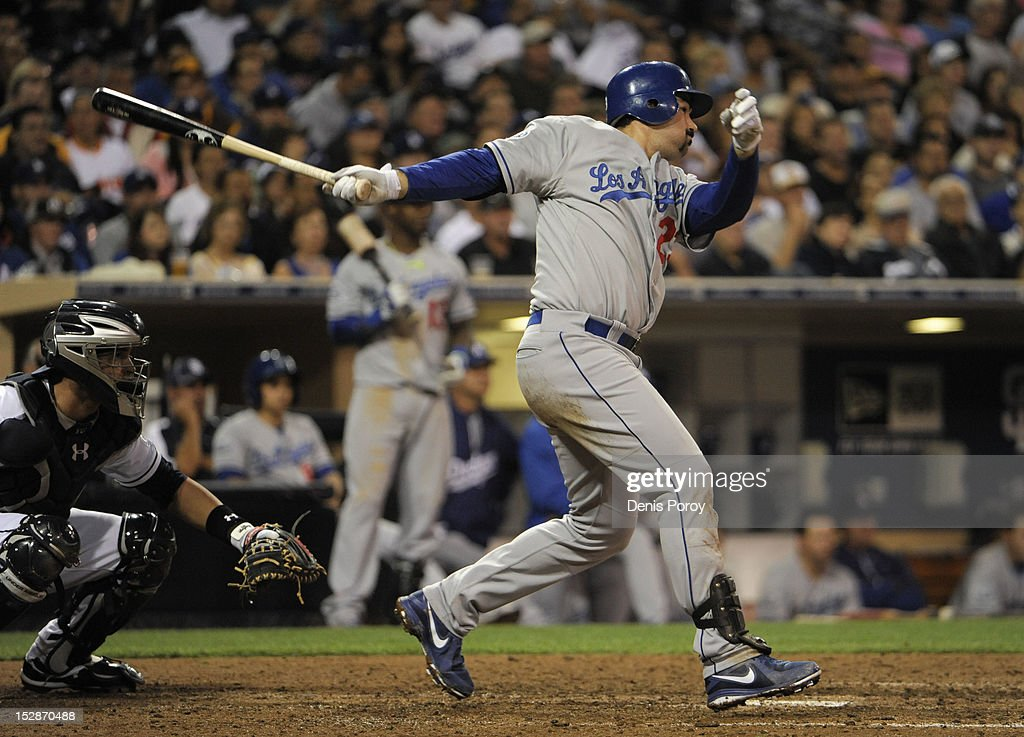 Adrian Gonzalez #23 of the Los Angeles Dodgers hits an RBI single during the sixth inning of a baseball game against the San Diego Padres at Petco Park on September 27, 2012 in San Diego, California.