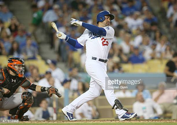 Adrian Gonzalez of the Los Angeles Dodgers hits an RBI single in the third inning against the San Francisco Giants at Dodger Stadium on June 19 2015...