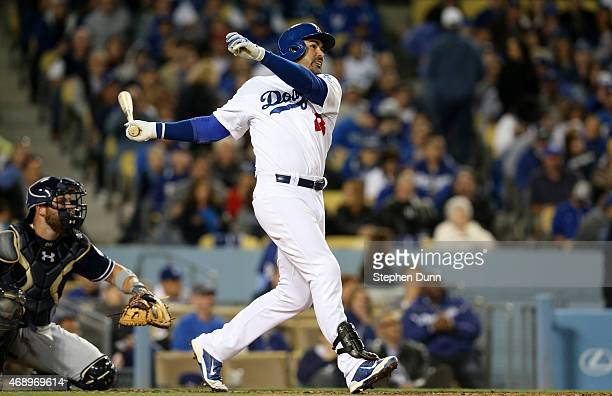 Adrian Gonzalez of the Los Angeles Dodgers hits his second home run of the game a solo shot in the third inning against the San Diego Padres at...