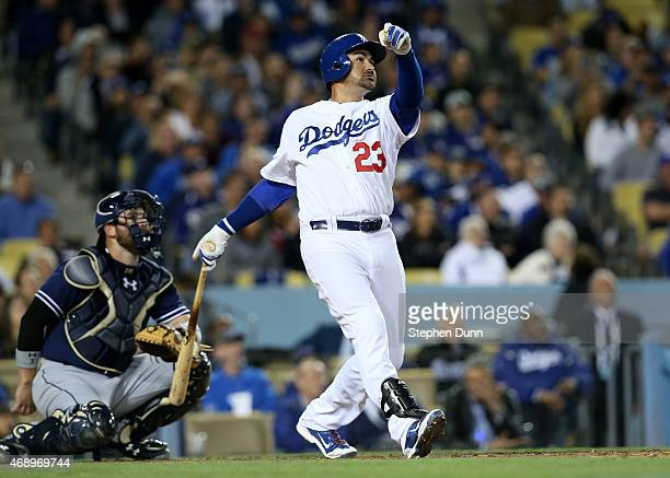 Adrian Gonzalez of the Los Angeles Dodgers hits his third home run of the game a solo shot in the fifth inning against the San Diego Padres at Dodger...