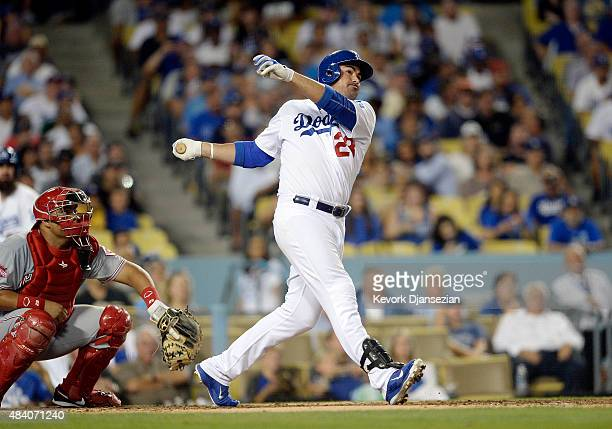 Adrian Gonzalez of the Los Angeles Dodgers hits threerun home run against pitcher John Lamb of the Cincinnati Reds to score Enrique Hernandez and...