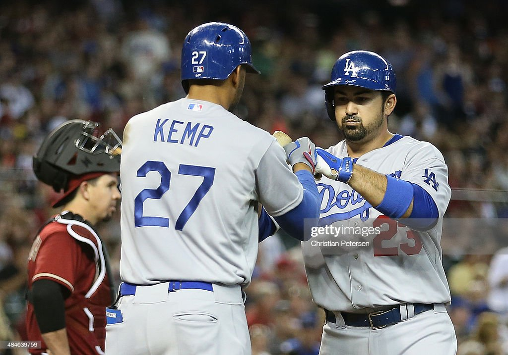 Adrian Gonzalez #23 of the Los Angeles Dodgers is congratulated by Matt Kemp #27 after Gonzalez hit a three-run home run against the Arizona Diamondbacks during the fourth inning of the the MLB game at Chase Field on April 13, 2014 in Phoenix, Arizona.