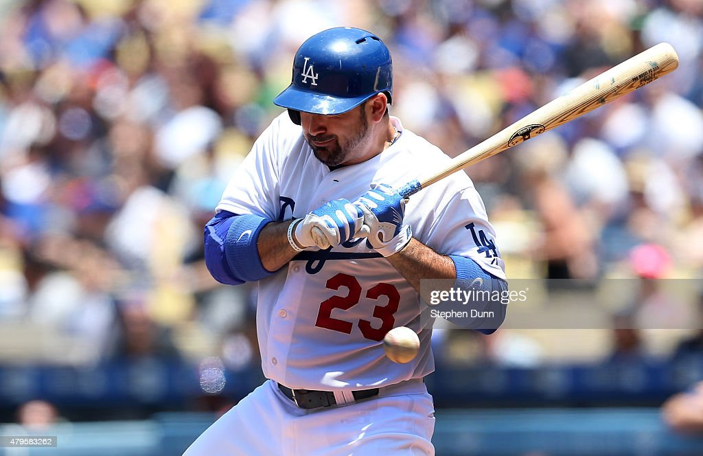 Adrian Gonzalez of the Los Angeles Dodgers is hit by a pitch in the first inning against the New York Mets at Dodger Stadium on July 5 2015 in Los...
