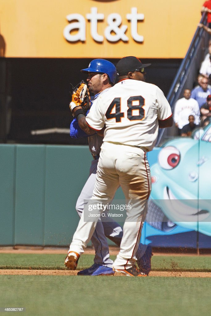 Adrian Gonzalez #23 of the Los Angeles Dodgers is tagged out between second and third base by Pablo Sandoval #48 of the San Francisco Giants during the eighth inning at AT&T Park on April 17, 2014 in San Francisco, California.