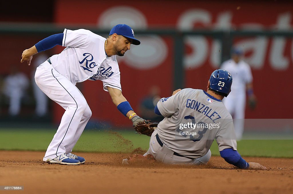 Adrian Gonzalez #23 of the Los Angeles Dodgers is tagged out by <a gi-track='captionPersonalityLinkClicked' href=/galleries/search?phrase=Omar+Infante&family=editorial&specificpeople=203255 ng-click='$event.stopPropagation()'>Omar Infante</a> #14 of the Kansas City Royals as he tries to steal second in the fourth inning at Kauffman Stadium on June 24, 2014 in Kansas City, Missouri.