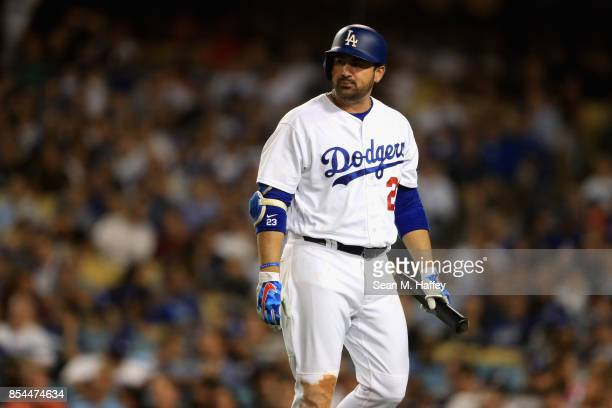 Adrian Gonzalez of the Los Angeles Dodgers looks on after striking out during the fourth inning of a game against the San Diego Padres at Dodger...