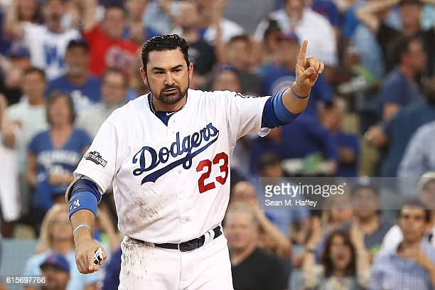 Adrian Gonzalez of the Los Angeles Dodgers reacts after being called out at home plate against the Chicago Cubs in the second inning of game four of...
