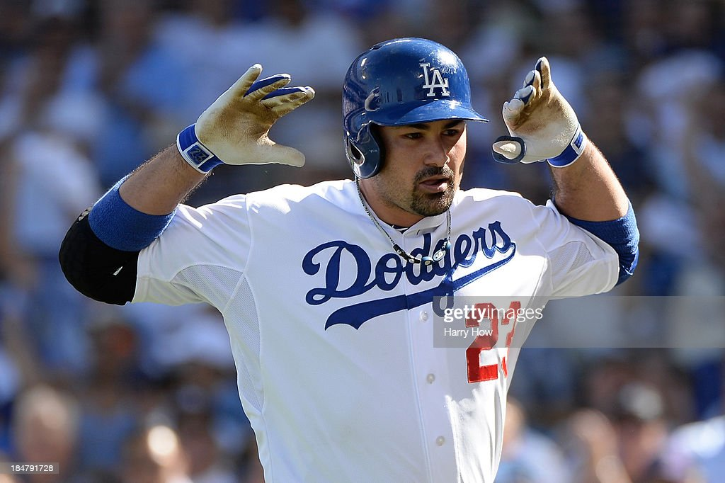 Adrian Gonzalez #23 of the Los Angeles Dodgers reacts after he hits a solo home run in the third inning against the St. Louis Cardinals in Game Five of the National League Championship Series at Dodger Stadium on October 16, 2013 in Los Angeles, California.