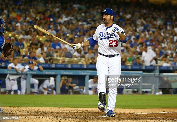 Adrian Gonzalez of the Los Angeles Dodgers reacts after striking out swinging in the sixth inning during the MLB game against the Chicago Cubs at...