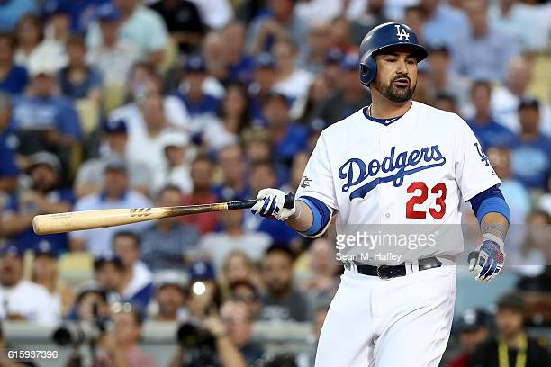 Adrian Gonzalez of the Los Angeles Dodgers reacts after striking out in the second inning against the Chicago Cubs in game five of the National...