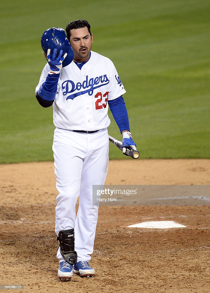 Adrian Gonzalez #23 of the Los Angeles Dodgers reacts to a strike during the sixth inning against the Arizona Diamondbacks at Dodger Stadium on May 7, 2013 in Los Angeles, California.
