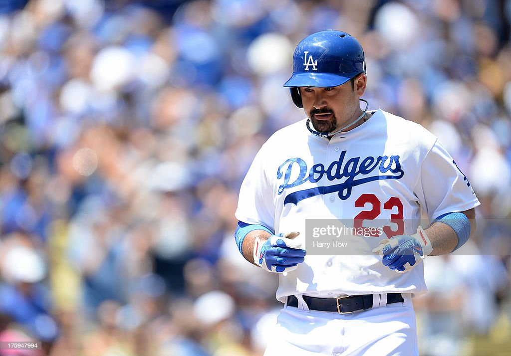 Adrian Gonzalez #23 of the Los Angeles Dodgers reacts to his two run homerun for a 2-0 lead over the Tampa Bay Rays during the first inning at Dodger Stadium on August 10, 2013 in Los Angeles, California.