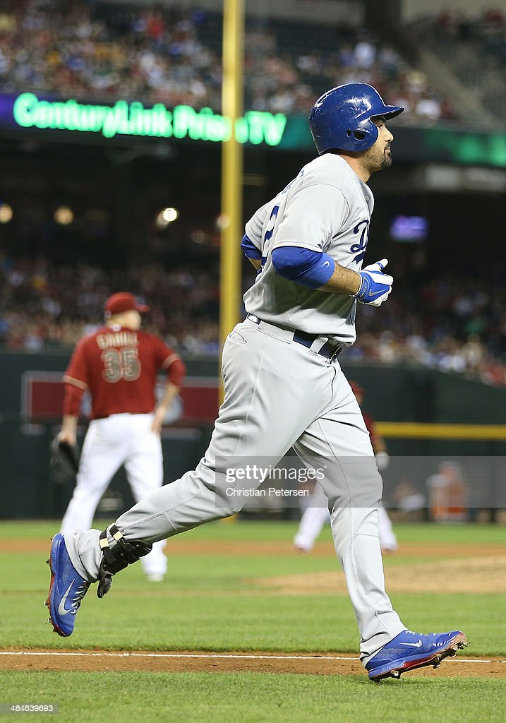 Adrian Gonzalez of the Los Angeles Dodgers rounds the bases after hitting a threerun home run off starting pitcher Trevor Cahill of the Arizona...