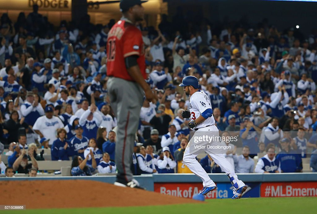 Adrian Gonzalez of the Los Angeles Dodgers rounds third base after hitting a solo homerun over the right center field wall in the fourth inning...