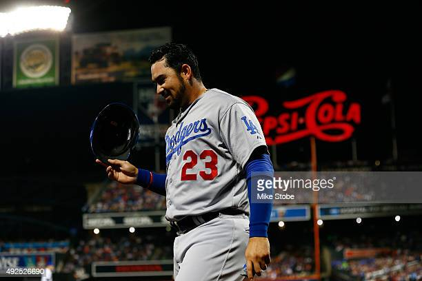 Adrian Gonzalez of the Los Angeles Dodgers smiles as he walks back to the dugout after scoring a run off of Justin Turner's double to left field...