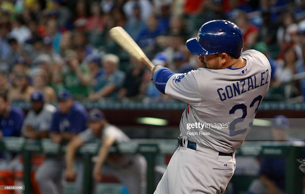 Adrian Gonzalez of the Los Angeles Dodgers swings at a pitch against the Arizona Diamondbacks during the first inning of a MLB game at Chase Field on...