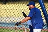 Adrian Gonzalez of the Los Angeles Dodgers waits his turn in the batting cage during batting practice prior to the MLB game Arizona Diamondbacks at...