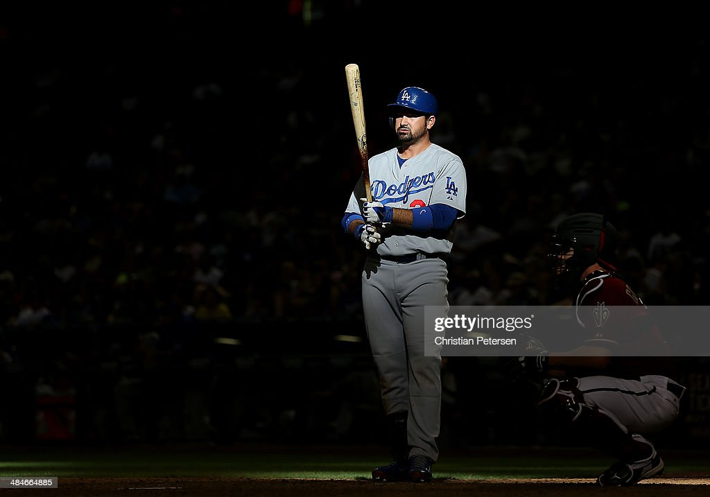 Adrian Gonzalez #23 of the Los Angeles Dodgers warms up while at bat during the ninth inning of the MLB game at Chase Field on April 13, 2014 in Phoenix, Arizona. The Dodgers defeated the Diamondbacks 8-6.