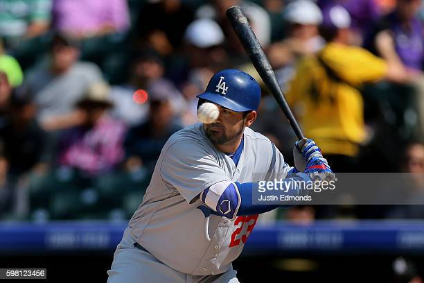 Adrian Gonzalez of the Los Angeles Dodgers watches a ball sail by during an at bat during the sixth inning against the Colorado Rockies at Coors...