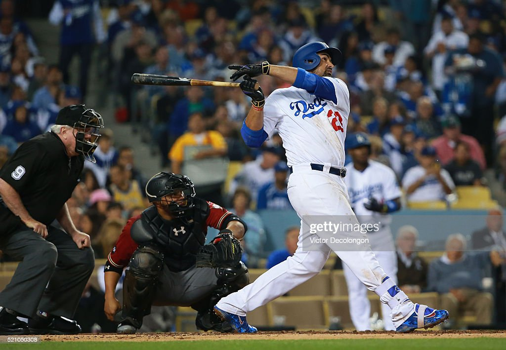 Adrian Gonzalez of the Los Angeles Dodgers watches his hit go over the right center wall for a solo homerun in the fourth inning against pitcher...