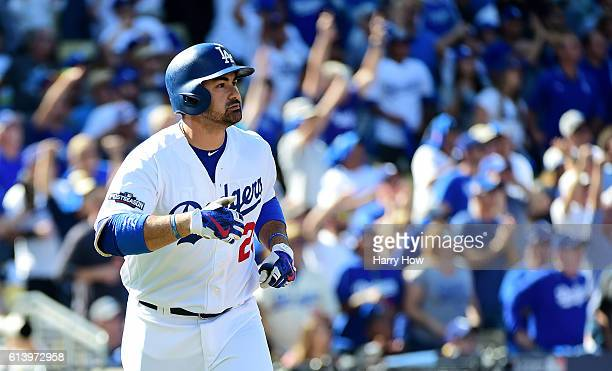 Adrian Gonzalez of the Los Angeles Dodgers watches his tworun homerun in the first inning against the Washington Nationals during game four of the...