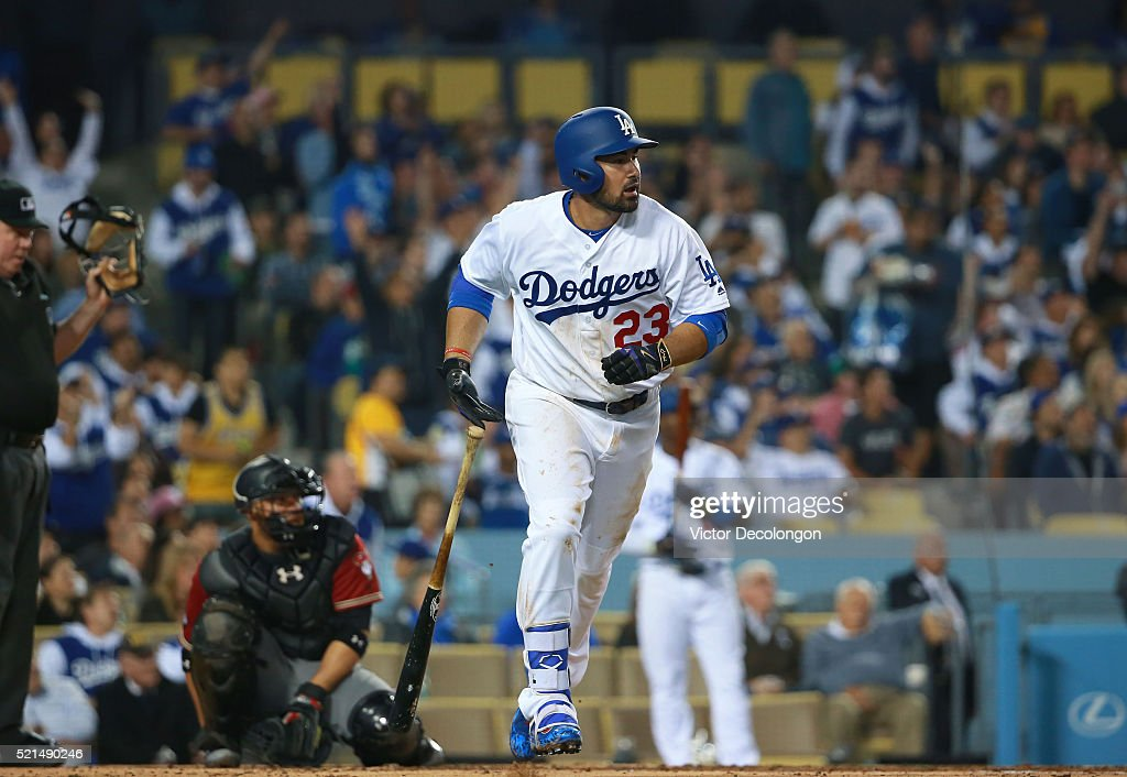 Adrian Gonzalez of the Los Angeles Dodgers watches the ball go over the right center field wall for a solo homerun in the fourth inning against...